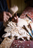 Sculptor wood worker in action. Sample Stock Photography
