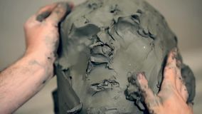 Sculptor is working on the creation of a monument stock footage