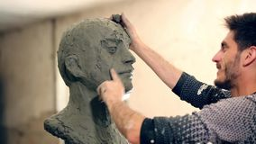 Sculptor is working on the creation of a monument stock video footage
