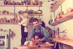 Sculptors in ceramics workroom with pottery wheel Royalty Free Stock Photography