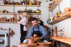 Sculptors in ceramics workroom with pottery wheel Stock Photo