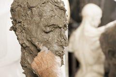 Sculptors forefinger on sculpture Stock Image