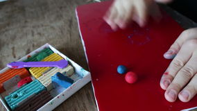 Sculpts from plasticine. Child sculpts crafts from colorful plasticine.Full HD 1920 x 1080, 29,97 fps stock footage
