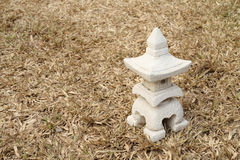 Sculptuer of house with a Chinese style roof on dry turf Royalty Free Stock Photo