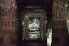 Sculptur of Buddha inside Ajanta temple, India. Sculpture of Buddha inside the temple of Ajanta, India. Red columns decorated with reliefs royalty free stock photography