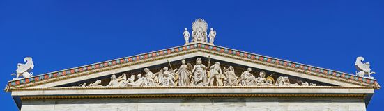 Sculptural complex of ancient twelve gods on academy building in Athens stock image