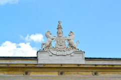 Sculptural composition of the coat of arms of noblemen Urusky on the building of the palace. Warsaw, Poland Royalty Free Stock Image