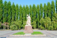 Sculptural composition Sorrowful Mother in Treptow Park, Berlin, Germany. BERLIN, GERMANY - SEPTEMBER 5, 2018: Sculptural composition `Sorrowful Mother` in royalty free stock photo