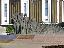 Sculptural composition -Tragedy of Peoples- against building of Museum Great Patriotic war. July 26, 2014, Victory Park on Poklonnaya hill, Moscow, Russia Stock Images