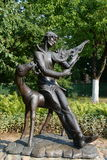 Sculptural composition `Vitebsk melody on the French violin`, a monument to Mark Chagall in the courtyard of the memorial house mu Stock Photo