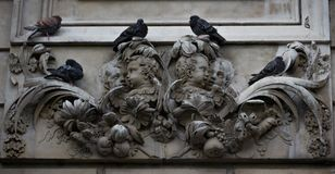 Sculptural Detail of St. Paul`s Cathedral. Outdoor sculptural façade of St. Paul`s Cathedral in London England with pigeons resting on it stock images