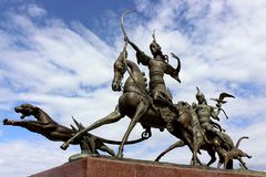 The sculptural ensemble `Royal hunt` by the Buryat sculptor Dashi Namdakov in the city of Kyzyl republic of Tuva. Kyzyl, Tuva, Russia - April 20, 2015: The Stock Photo