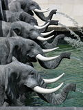 Sculptural fountain element in shape of five heads of elephants with trunks. Royalty Free Stock Photography