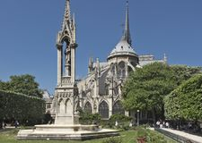 Fountain of Our Lady behind the Notre Dame Cathedral in Paris stock photography