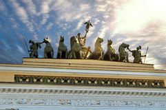 Sculptural group named Chariot of Fame lit by sunlight on the roof of the Headquarters in Saint-Petersburg, Russia Royalty Free Stock Photos