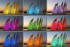 Sculptural group sail with changing colors at sunset in Ashdod, Israel. Collage Stock Image