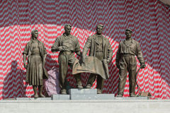 Sculptural group of Soviet times. Kiev, Ukraine. Sculptural group of Soviet times glorifying the workers of the Soviet era. Kiev, Ukraine stock photography