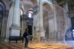 Sculptural installation by Jaume Plensa during Venice Art Biennale in May 2015 inside San Giorgio Maggiore church in Italy. Sculptural installation by Jaume royalty free stock photography