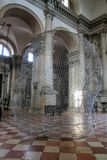 Sculptural installation by Jaume Plensa during Venice Art Biennale in May 2015 inside San Giorgio Maggiore church in Italy. Sculptural installation by Jaume royalty free stock images