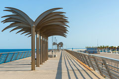 Sculptural palm trees on on the seaside esplanade at Muelle de L Stock Images