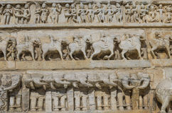 Sculptural relief with the image of living beings Royalty Free Stock Photo