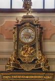 Sculptural table clock. Vintage sculptural desk clock in gold Stock Photography