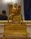 Sculptural table clock. Vintage sculptural desk clock in gold Royalty Free Stock Photo