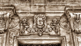 Sculpture above door frame. Malta HDR sepia tone Royalty Free Stock Images