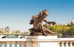 The sculpture of Alexandre III bridge, Paris, France. Royalty Free Stock Photo