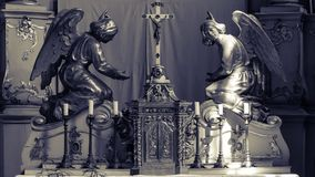 Sculpture on Altar. Shallow Depth of Field Black and White Split Toning, Religious Photography Stock Photos