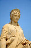 Sculpture of ancient lady with blue sky. Stock Image
