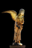 Sculpture of angel. Isolated stone statue of an angel, picture taken on a cemetery Royalty Free Stock Photos