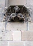 Sculpture of an angel. A statue of an angel praying Stock Photography