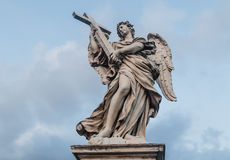 Sculpture of an angel on the bridge of Sant`Angelo in Rome, Ital Royalty Free Stock Photos