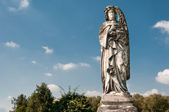 The sculpture of an angel with cross Royalty Free Stock Image