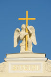 Sculpture of an angel with a cross. Stock Photos