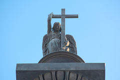 Sculpture of an angel with cross and snake Royalty Free Stock Photo