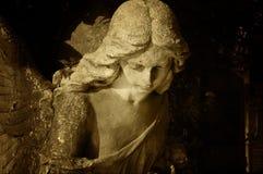 Sculpture of an angel with dark background (retro)