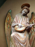 Sculpture of an angel with mandolin. Chiusi Stock Photos