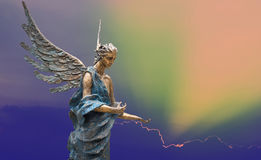 Sculpture of angel over bright sky Stock Photo
