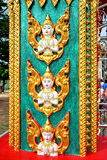 Sculpture of angel at a pole in a temple in THailand. Normally, there are many decoration at wall, pole, roof, and everywhere in Thai temple. This is one of the Stock Photo