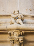 Sculpture of an angel and a skull in Burgos Cathedral Royalty Free Stock Images