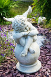 Sculpture of an angel with wings. In the garden Stock Photos