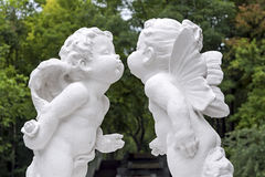 Sculpture of angels in park. Sculpture of kissing angels in park Stock Photos