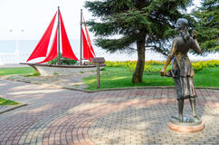 Sculpture Assol and landscape composition Sailboat on Gelendzhik promenade. Sculpture Assol and landscape composition Sailboat created based on the novel by stock photo