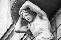 Sculpture of Atlant on the facade of old house Royalty Free Stock Images