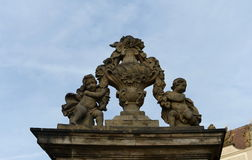 Sculpture babies at the entrance to Prague castle. Royalty Free Stock Photo