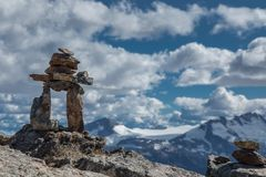 Inukshuk Rocks and Mountain View Royalty Free Stock Images