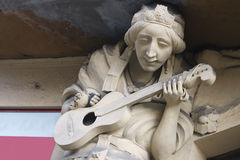 Sculpture of bard playing the guitar in Prague Stock Image