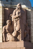 Sculpture on the basis of the Freedom Monument in Riga Royalty Free Stock Image